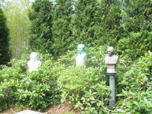 The above two images show how to play down formality and infuse some humor. The busts peeking from the greenery look like a game of Hide and Seek is underway.